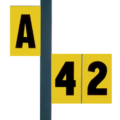 Szyldy regałowe i alejkowe - oznakowanie regałów